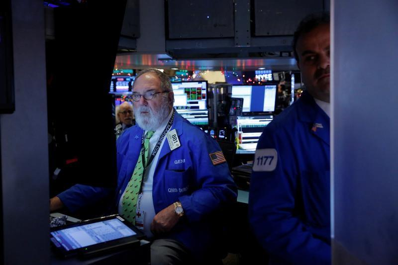 Traders work on the floor at the opening of the day's trading at the New York Stock Exchange (NYSE) in Manhattan, New York City