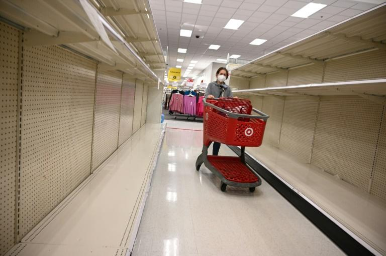 Paper towels and other cleaning supplies are flying off retail shelves in California, where a curfew has been announced across much of the state to try to tackle the Covid surge