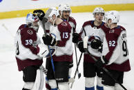 Colorado Avalanche's Pavel Francouz (39), of the Czech Republic, Valeri Nichushkin (13), of Russia, Matt Nieto (83), Samuel Girard (49) and Gabriel Landeskog (92), of Sweden, celebrate after a win against the Minnesota Wild in an NHL hockey game Sunday, Feb. 9, 2020, in St. Paul, Minn. The Avalanche won 3-2. (AP Photo/Hannah Foslien)