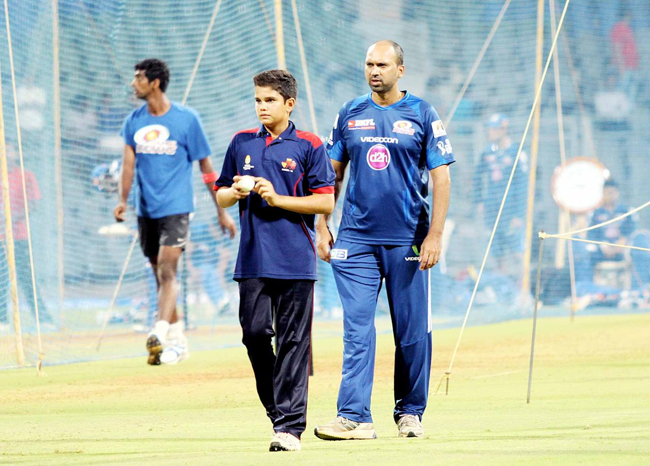 Arjun Tendulkar, son of Sachin Tendulkar, at a Mumbai Indians net session as assistant coach Paras Mhambrey looks on. (Yogen Shah)