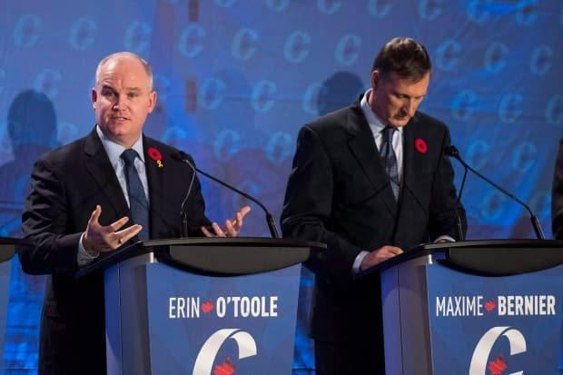 Conservative leadership candidate Erin O'Toole, left, speaks as Maxime Bernier listens during the Conservative leadership debate in Saskatoon, Wednesday, November 9, 2016. (Liam Richards/Canadian Press - image credit)