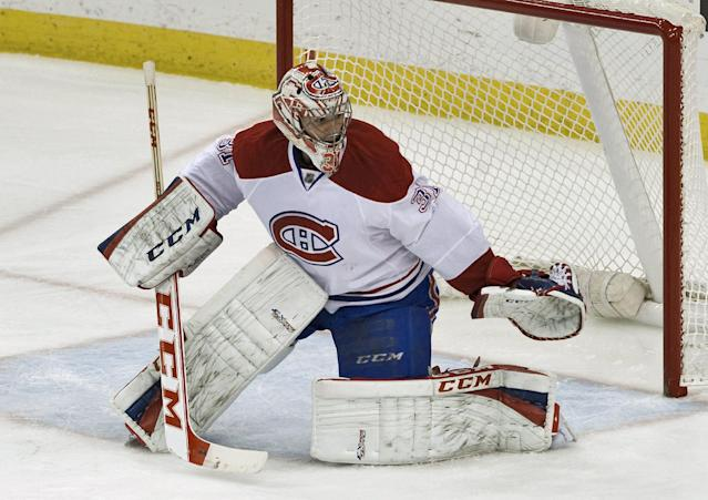 Montreal Canadiens goalie Carey Price defends his net during the first period of an NHL hockey game against the Tampa Bay Lightning on Saturday, Dec. 28, 2013, in Tampa, Fla. (AP Photo/Steve Nesius)