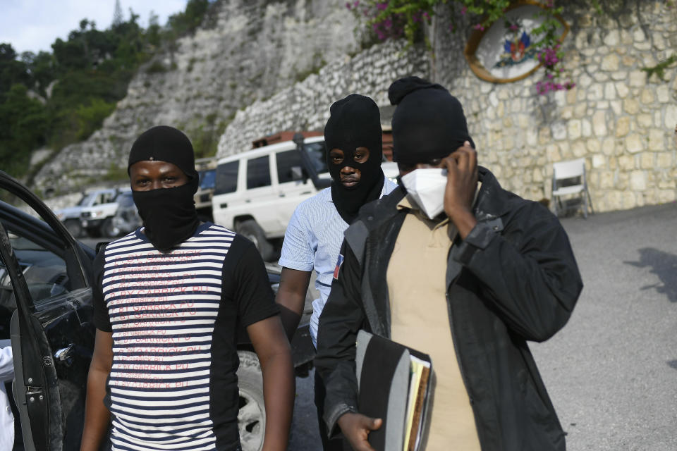 Police officers investigating the assassination of President Jovenel Moise leave his residence in Port-au-Prince, Haiti, Thursday, July 15, 2021. President Moise was assassinated in his home on July 7. (AP Photo/Matias Delacroix)