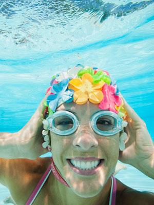 """<div class=""""caption-credit""""> Photo by: Getty Images</div><div class=""""caption-title"""">#2: Never Shampoo Before Your Swim</div>Whether at the pool or ocean, don't jump in with freshly washed hair (unless you're donning a swim cap). Chlorine, chemicals, and salt water are rough on cuticles, and freshly-washed tresses are more vulnerable to damage. <br>"""