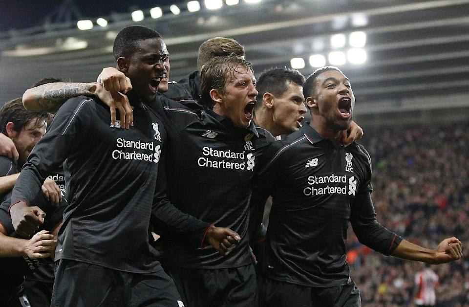Liverpool's Daniel Origi (L) celebrates with teammates after scoring his side's fourth goal League Cup quarter-final against Southampton at St Mary's Stadium on December 2, 2015 (AFP Photo/Adrian Dennis)