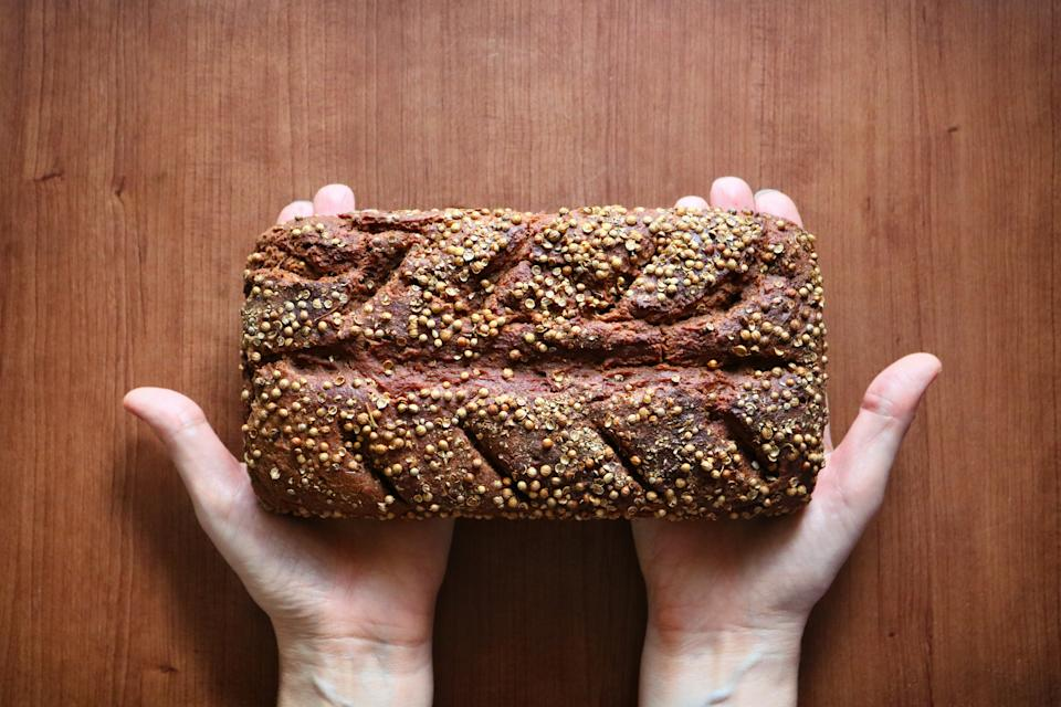 Trading white bread for whole grain loafs like rye is a delicious way to decrease sugar. (Photo: Getty Images)