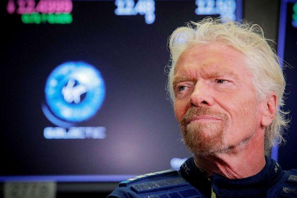 PHOTO: Sir Richard Branson stands on the floor of the New York Stock Exchange ahead of Virgin Galactic trading in New York, Oct. 28, 2019. (Brendan Mcdermid/Reuters, FILE)