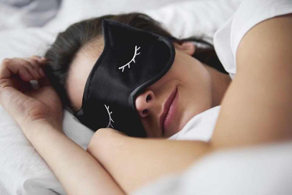 """<p>Dr. Wu and Dr. Buenaver suggested a few ways to deal with the sleep issues created by blue light. If you find yourself mindlessly scrolling Instagram or clicking yet another video as it gets closer to bedtime, try a few of these techniques to keep your sleep cycle on track:</p> <ul> <li><strong>Enable your device's <a href=""""https://www.popsugar.com/fitness/Can-Bedtime-iPhone-Improve-Your-Sleep-46429317"""" class=""""link rapid-noclick-resp"""" rel=""""nofollow noopener"""" target=""""_blank"""" data-ylk=""""slk:&quot;night mode&quot; function"""">""""night mode"""" function</a>.</strong> Your phone or laptop's """"night mode"""" or """"dark mode"""" filters out the blue light from your screen. """"It makes your screen look kind of orange-ish. Make sure to enable that,"""" Dr. Wu said, if you're going to looking at your screen close to bedtime. </li> <li><strong>Use blue-light-filtering glasses.</strong> If your screen doesn't have a night mode function, both doctors said that blue-light-filtering glasses work in the same way. Here are <a href=""""https://www.popsugar.com/smart-living/Best-Blue-Light-Glasses-45742093"""" class=""""link rapid-noclick-resp"""" rel=""""nofollow noopener"""" target=""""_blank"""" data-ylk=""""slk:10 blue-light glasses you can try"""">10 blue-light glasses you can try</a>.</li> <li><strong>Dim any ambient lighting.</strong> Since regular light exposure can also suppress melatonin, Dr. Wu recommended dimming your overhead lights more and more as you get closer to bedtime. This might mean moving from the well-lit living room to your darker bedroom, or switching from an overhead light to a smaller reading light. This can help bring your circadian rhythm back on track.</li> <li><strong>Put down your phone or computer at least 30 minutes before bed.</strong> This is the hardest one, we know. """"Everyone's always connected to their devices,"""" Dr. Wu said. """"But usually we recommend at least a 30-minute or one-hour wind-down period, if possible."""" Dr. Buenaver recommended trying for a two-hour window - more of a challenge, but"""