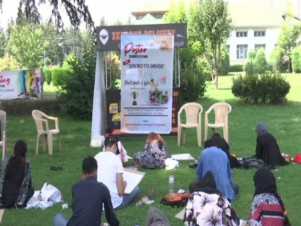 Students participating in the poster competition  in Kashmir University, Srinagar. (Photo/ANI)