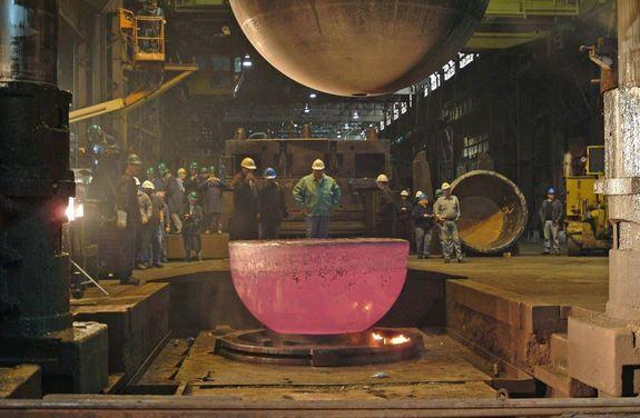 A new, slightly larger sphere was forged from titanium to replace the old personnel sphere. Above, one of two new hemispheres cools