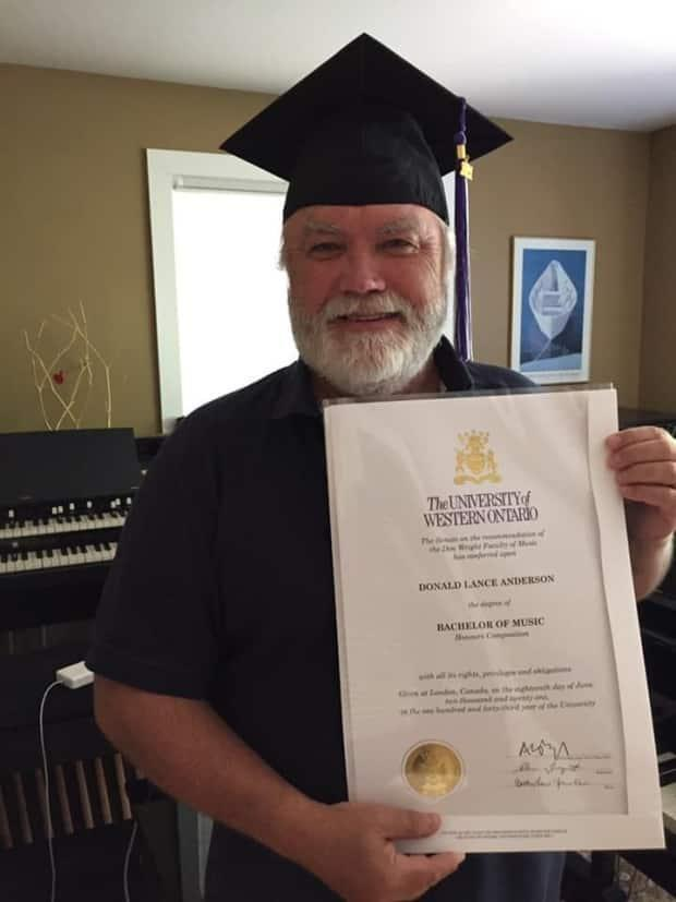 Lance Anderson poses with his official Western University bachelor's degree, nearly 50 years after his finished his last course. The celebrated music producer, composer and writer is based in Orillia, Ont. (Submitted by Lance Anderson - image credit)