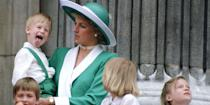 <p>The young royal sticks his tongue out while watching the annual Trooping the Colour from the balcony of Buckingham Palace.</p>