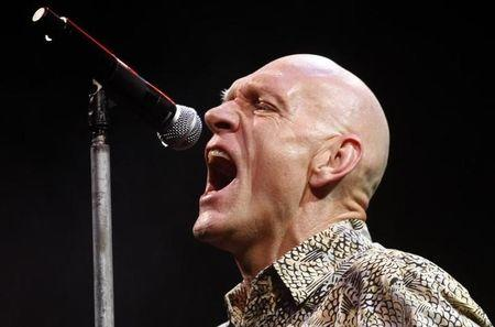 File photo - Australia's Environment Garrett performs with his band Midnight Oil during the Sound Relief bushfire benefit concert in Melbourne
