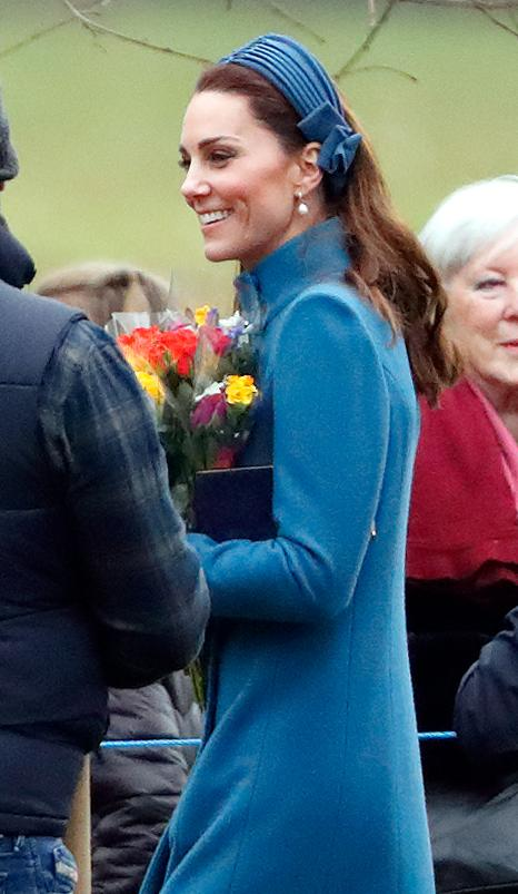 <p>Kate was even seen holding a beautiful bouquet of yellow and orange flowers before heading inside. Photo: Getty </p>