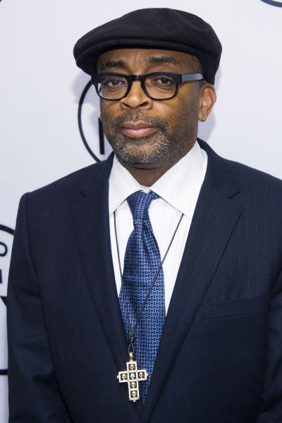 "FILE - In this June 10, 2013 file photo, Spike Lee attends the eighth annual Made in New York Awards in New York. Lee has launched a Kickstarter campaign to help fund his next feature film. The Brooklyn director on Monday unveiled his bid to raise $1.25 million over the next month. Lee offered few details on the film, but said it would be about ""the addiction of blood."" (Photo by Charles Sykes/Invision/AP, File)"