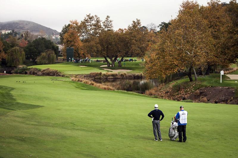 Tiger Woods waits to take his second shot on the second hole during the first round of the World Challenge golf tournament at Sherwood Country Club in Thousand Oaks, Calif., Thursday, Nov. 29, 2012. (AP Photo/Bret Hartman)