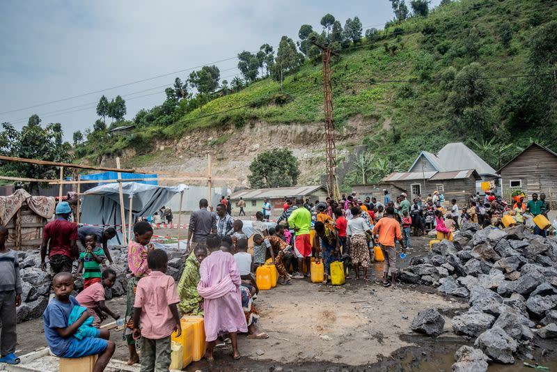 FILE PHOTO: Doctors Without Borders (MSF) team members help displaced Congolese evacuated from their homes destroyed by the eruption of Mount Nyiragongo, in Sake