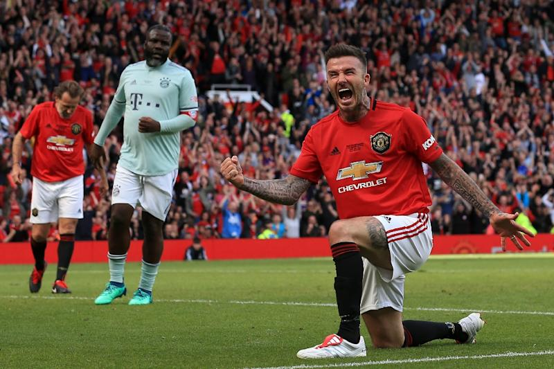 David Beckham made the most of his return to Old Trafford with Manchester United's legends (AFP Photo/Lindsey PARNABY)