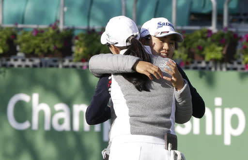 Nasa Hataoka, right, of Japan hugs Minjee Lee of Australia after finishing the first round of the LPGA KEB Hana Bank Championship at Sky72 Golf Club in Incheon, South Korea, Thursday, Oct. 11, 2018. (AP Photo/Ahn Young-joon)
