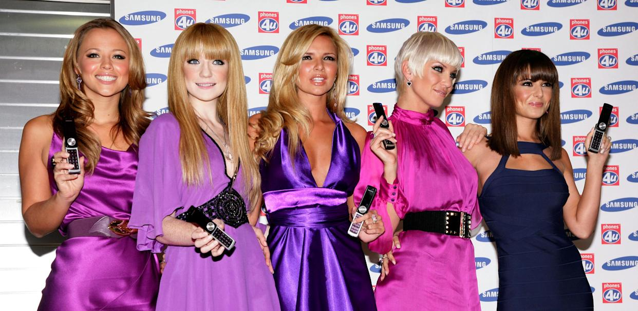Girls Aloud (left-right) Kimberley Walsh, Nicola Roberts, Nadine Coyle, Sarah Harding and Cheryl Cole at the launch of the Samsung F210 Purple phone, at Phones 4U on Oxford Street, central London.   (Photo by Yui Mok - PA Images/PA Images via Getty Images)