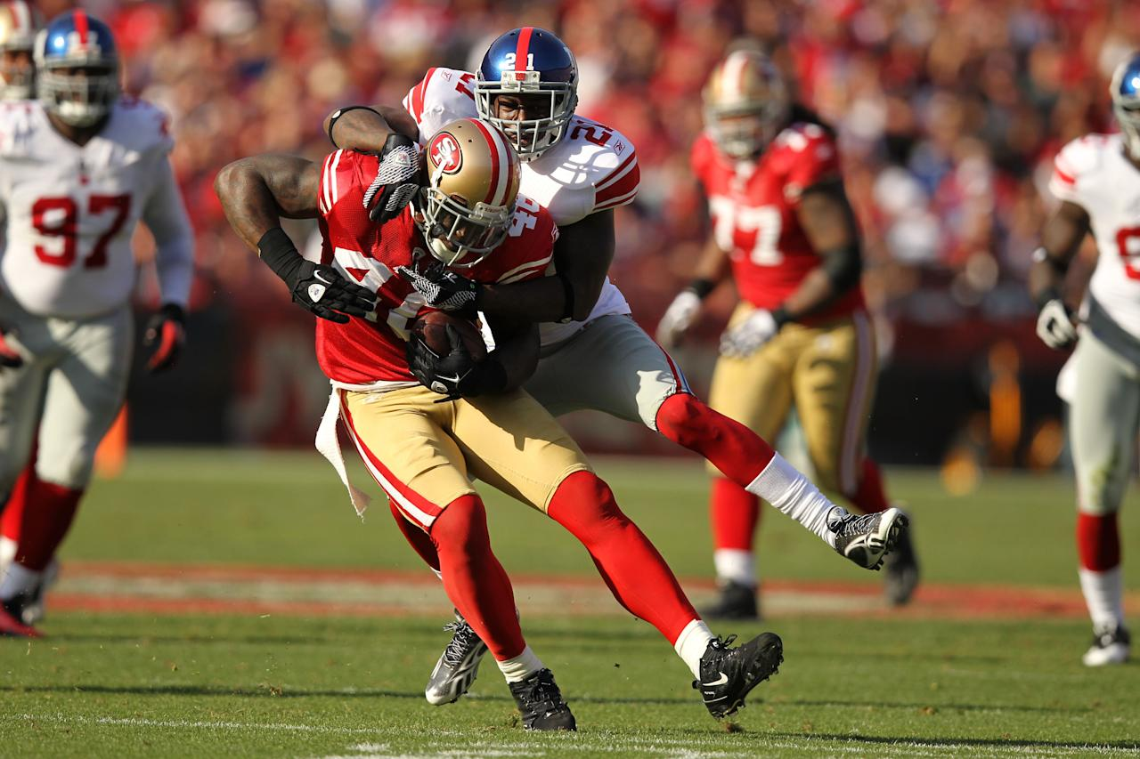 SAN FRANCISCO, CA - NOVEMBER 13:  Delanie Walker #46 of the San Francisco 49ers is tackled by Kenny Phillips #21 of the New York Giants at Candlestick Park on November 13, 2011 in San Francisco, California.  (Photo by Ezra Shaw/Getty Images)