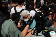 Riot police disperse anti-national security law protesters during a march at the anniversary of Hong Kong's handover to China from Britain in Hong Kong