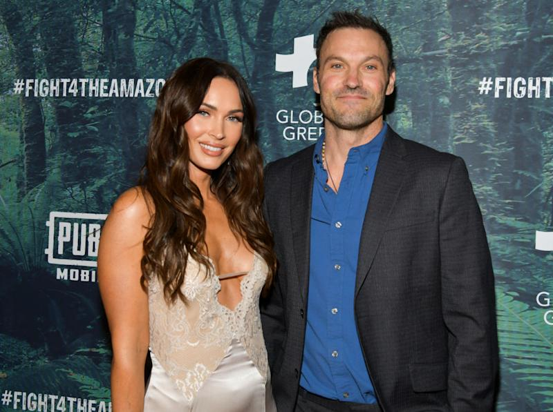 Megan Fox and her husband Brian Austin Green pose for a photo at the Fight 4 The Amazon event