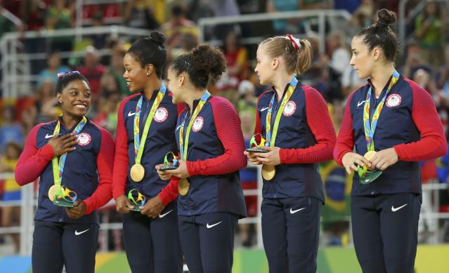 2016 Rio Olympics - Artistic Gymnastics - Women's Team Victory Ceremony - Rio Olympic Arena - Rio de Janeiro, Brazil - 09/08/2016. (L-R) Simone Biles (USA) of USA, Gabrielle Douglas (USA) of USA (Gabby Douglas), Laurie Hernandez (USA) of USA, Madison Kocian (USA) of USA, Alexandra Raisman (USA) of USA (Aly Raisman) on the podium with their gold medals after winning the women's team final. REUTERS/Mike Blake FOR EDITORIAL USE ONLY. NOT FOR SALE FOR MARKETING OR ADVERTISING CAMPAIGNS.