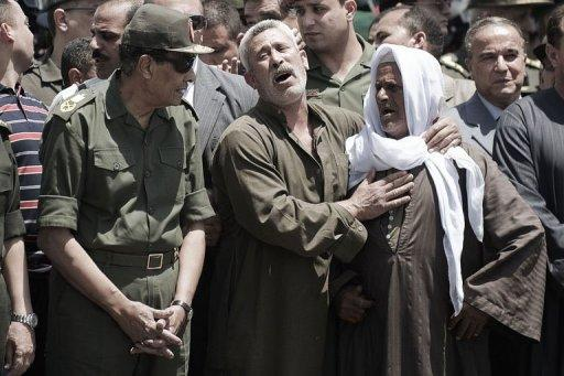 Field Marshal Hussein Tantawi (left) attends the funeral of a member of Egypt's special forces in Cairo