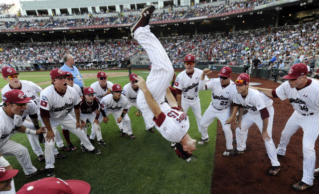 South Carolina's Nolan Belcher performs his traditional back flip before Game 2 of the NCAA College World Series baseball finals against Arizona, in Omaha, Neb., Monday, June 25, 2012. (AP Photo/Eric Francis)
