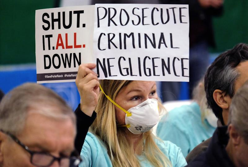 Tera Lecuona of Porter Ranch holds a protest sign during a hearing over the October 2015 blowout at Aliso Canyon.