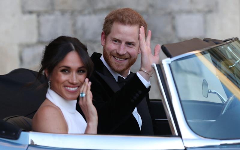 The newlywed Harry and Meghan drive to Frogmore House for their wedding reception in 2018 - PA