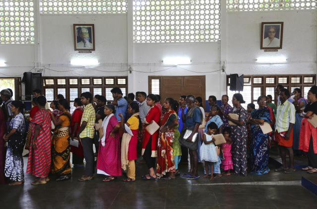 <p>Flood affected victims stand in a queue for food at a relief camp set up inside a school in Kochi, in the southern Indian state of Kerala, Thursday, Aug. 23, 2018. A political battle is brewing in flood-ravaged south India, with the ruling party in Kerala state protesting the central government's refusal to accept more than $100 million in foreign relief. (AP Photo/Aijaz Rahi) </p>