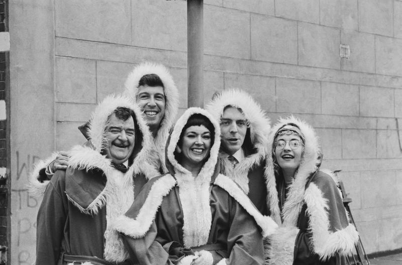 The cast of Hi-de-Hi! wearing Christmas outfits, UK, 19th September 1983; they are (L-R) Paul Shane (1940 - 2013), Jeffrey Holland, Ruth Madoc, Simon Cadell (1950 - 1996), and Su Pollard. (Photo by Len Trievnor/Daily Express/Hulton Archive/Getty Images)