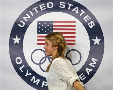 Figure skater Ashley Wagner walks offstage after being introduced as part of the United States' women's figure skating team for the upcoming Sochi Winter Olympics, during a news conference at the U.S. Figure Skating Championships in Boston, Massachusetts January 12, 2014. REUTERS/Brian Snyder