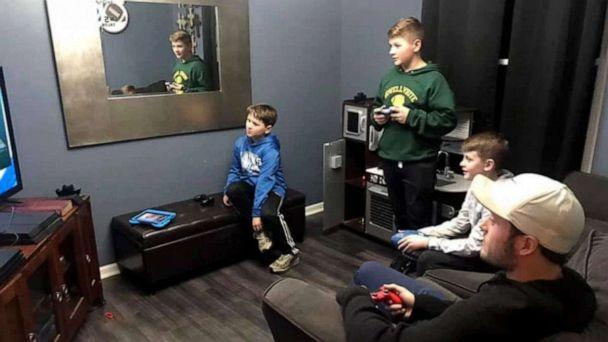 PHOTO: Brothers Tyson, Talon and Skyler, play video games with NFL quarterback Matthew Stafford. Talon told ABC News he'd never forget losing to Stafford in 'Madden.' (Shannon Webb)