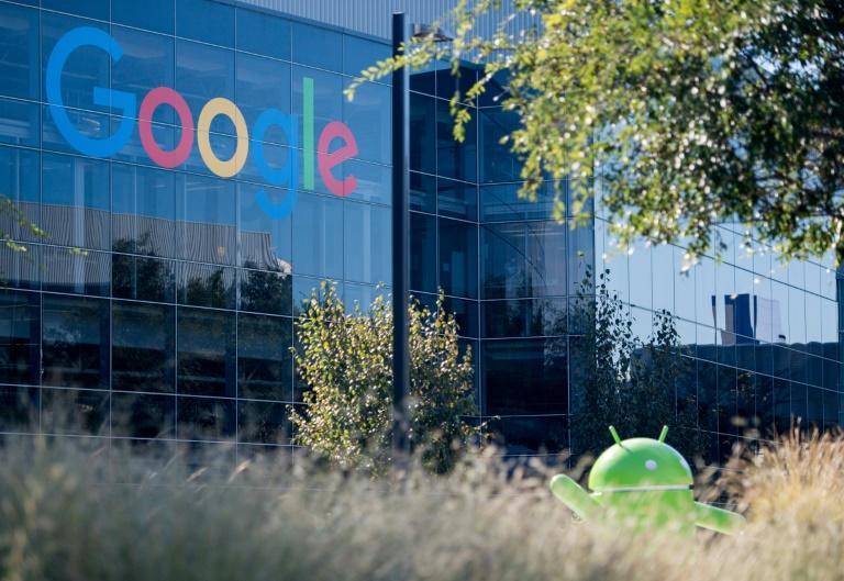 A Google logo and Android statue are seen at the Googleplex in Menlo Park, California on November 4, 2016