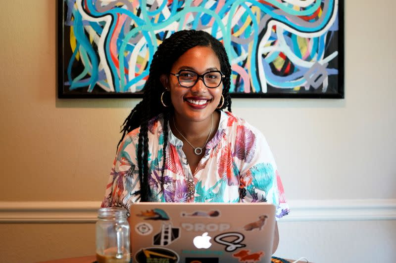 Jaleesa Garland, a marketing manager at an e-commerce startup, poses for a portrait in her apartment in Tulsa