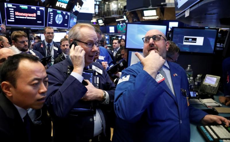 Traders gather for the IPO of Singapore-based Sea Limited on the floor of the NYSE in New York