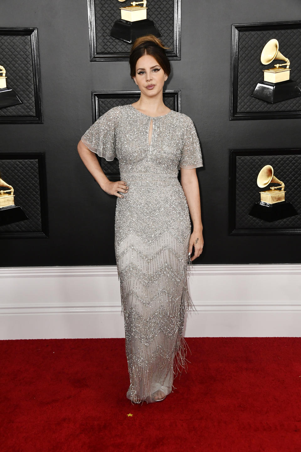"""The """"Norman F--king Rockwell"""" singer-songwriter hit the red carpet in a silver vintage-inspired gown with fringe detail. Del Rey was nominated for two awards, including Album Of The Year."""
