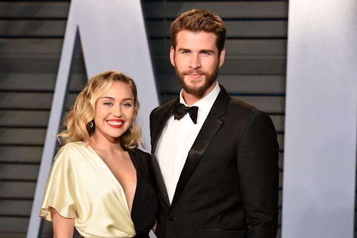 Miley Cyrus and Liam Hemsworth attend the 2018 Vanity Fair Oscar Party March 4, 2018, in Los Angeles. (Photo: Presley Ann/Patrick McMullan via Getty Images)