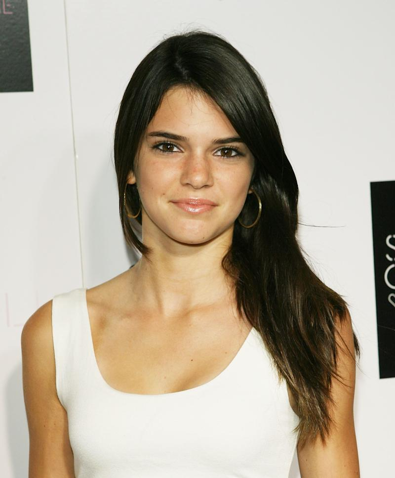 At only 14 years old, Kendall Jenner steps out of the family limelight and into her own. She arrives at the 'Kiss & Tell' record release party in 2009 fresh faced, with simple black eyeliner and glossy lip.