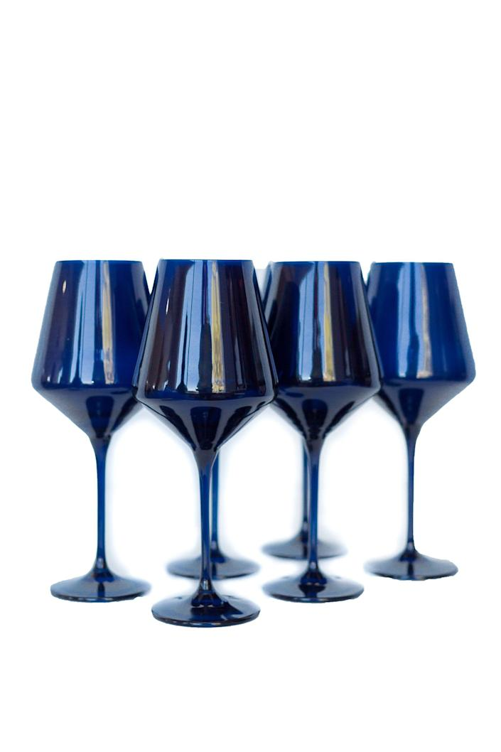 """<p><strong>Estelle Colored</strong></p><p>estellecoloredglass.com</p><p><strong>$175.00</strong></p><p><a href=""""https://estellecoloredglass.com/collections/all/products/estelle-colored-wine-stemware-set-of-6-midnight-blue"""" rel=""""nofollow noopener"""" target=""""_blank"""" data-ylk=""""slk:Shop Now"""" class=""""link rapid-noclick-resp"""">Shop Now</a></p><p>Are you sick at looking at the glasses you received for your wedding decades ago? Upgrade with these depression-glass inspired wine glasses in a bold cobalt blue. <br></p>"""