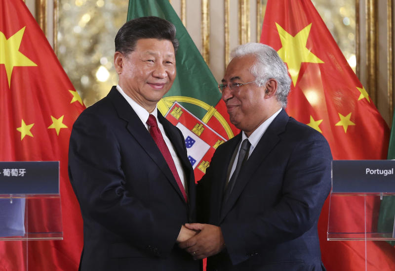 China's President Xi Jinping and Portuguese Prime Minister Antonio Costa, right, shake hands after the signing of agreements between the two governments Wednesday, Dec. 5, 2018, at the Queluz National Palace in Queluz, outside Lisbon. Xi closes Wednesday a two-day state visit to Portugal with the two countries signing a memorandum of understanding on cooperation within China's modern Silk Road initiative, with special emphasis on transport connections and energy. (AP Photo/Armando Franca)