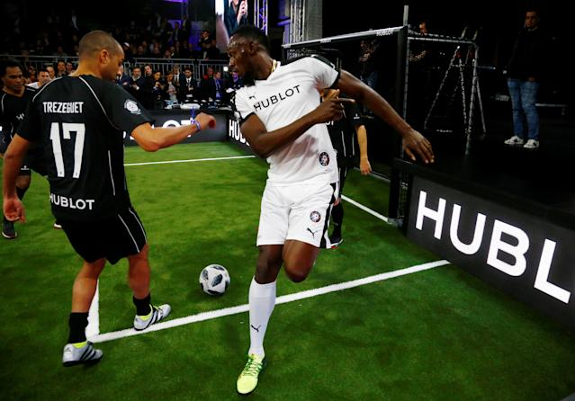 Soccer Football - Hublot Match of Friendship - Congress Center, Basel, Switzerland - March 21, 2018 Usain Bolt of Team Jose Mourinho in action with David Trezeguet of Team Diego Maradona REUTERS/Arnd Wiegmann