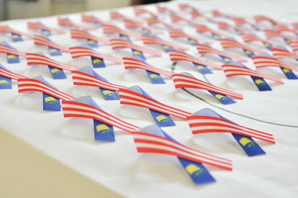 Grab Malaysia is collaborating with local social enterprise Projek57 to celebrate Malaysia Day by giving out Unity Ribbons. — Picture courtesy of Grab Malaysia
