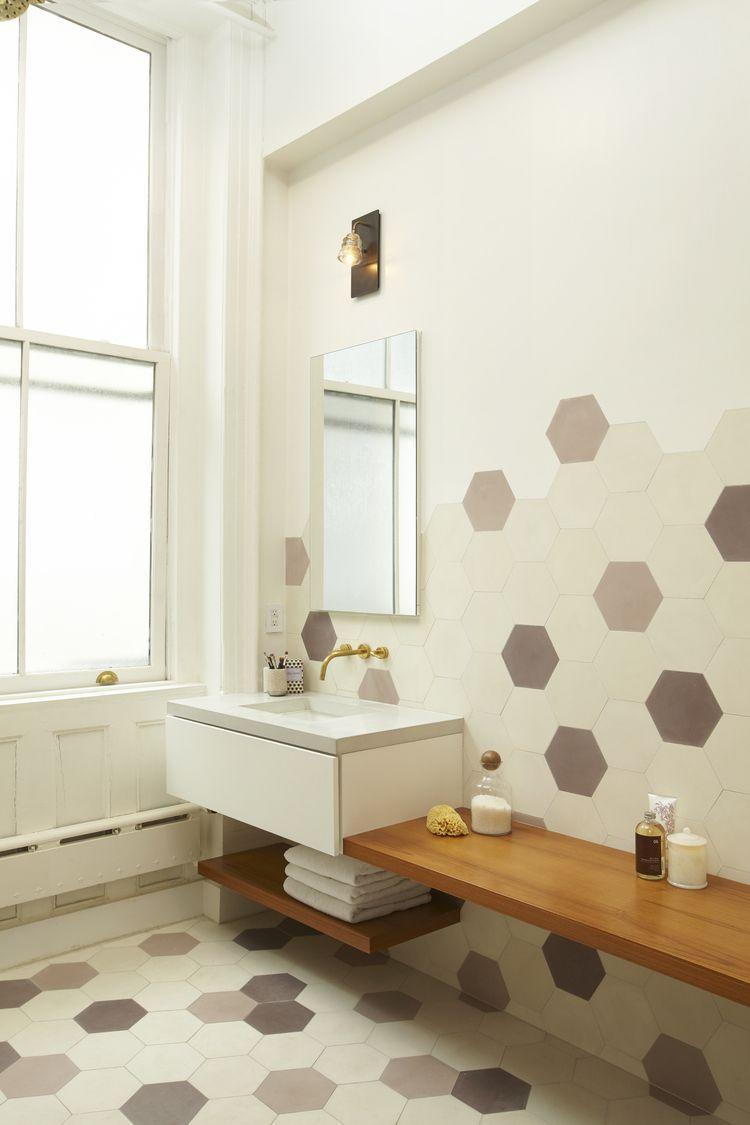 <p>If you don't want to tile your entire wall, just go half way. The seamless transition from floor to wall is super unique, so bring your color-blocking to the next level with a hexagon scheme like this one. </p>