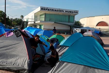 Central American migrants are seen in an encampment in Matamoros