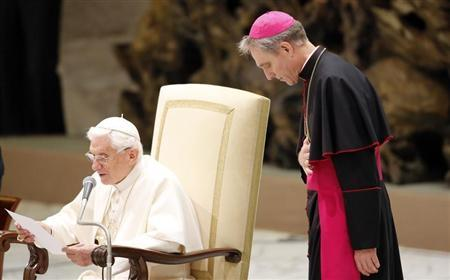 Pope Benedict XVI speaks next to his private secretary Archbishop Georg Ganswein during the weekly audience in the Vatican January 16, 2013. REUTERS/Stefano Rellandini