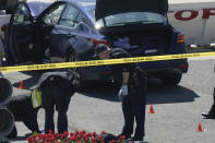 U.S. Capitol Police officers investigate near a car that crashed into a barrier on Capitol Hill near the Senate side fo the U.S. Capitol in Washington, Friday, April 2, 2021. (AP Photo/J. Scott Applewhite)